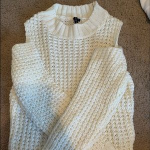 Sweater shoulders are cut out